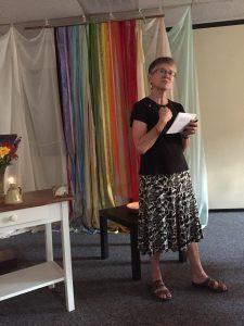 Libby Smith leading a candle lighting vigil to remember Orlando at Perkasie Mennonite Church